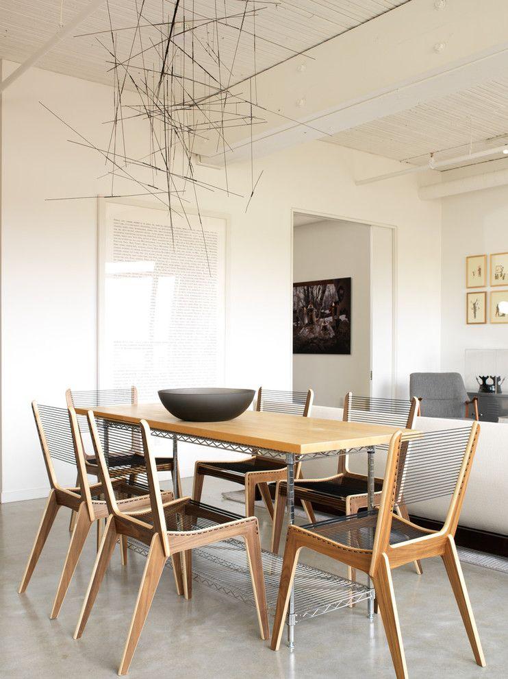Eklektische Einrichtung im modernen Essraum-Steinoptik Steinwand Innendesign Designer Esszimmer