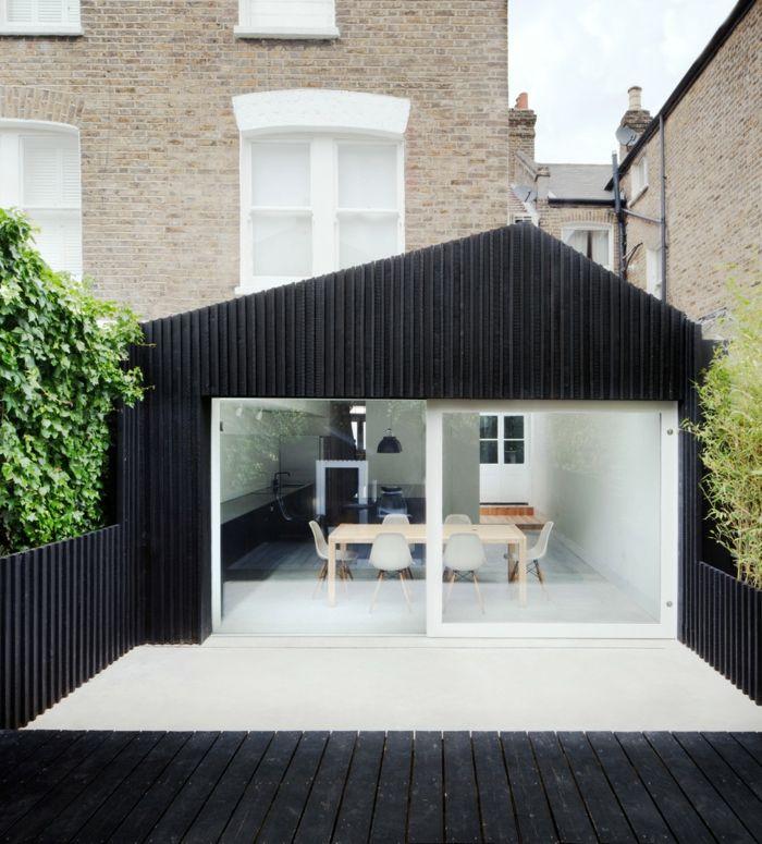 Stilvolle Hauserweiterung mit direktem Zugang zum Garten-stilvoll Hausanbau Hinterhof Sichtschutz Zaun
