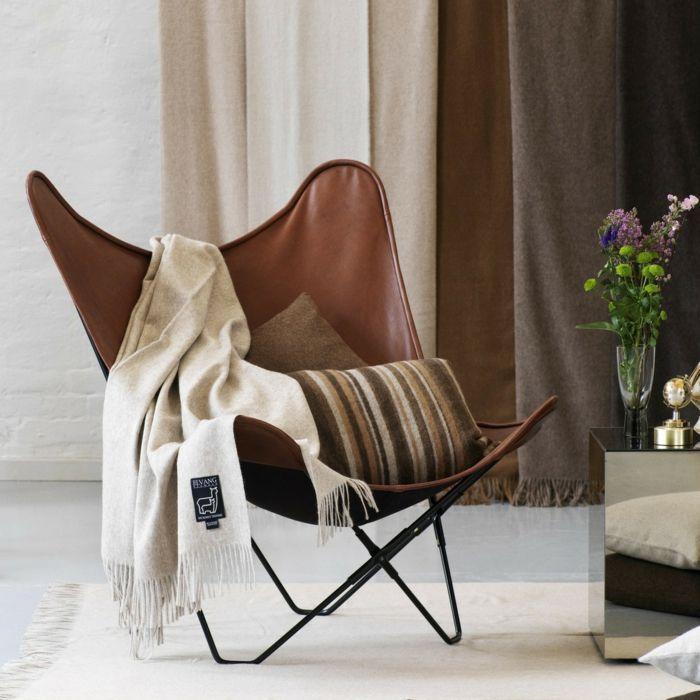 Eine hochwertige Wolldecke in dänischem Design bringt eine klassische Note ins Wohndesign- und Schafswolle Heimtextilien Tagesdecke