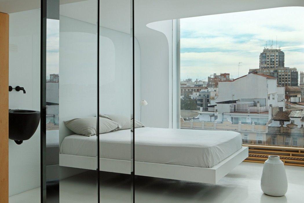 Hauptschlafzimmer Bad en suite Holzfronten Steinfarben