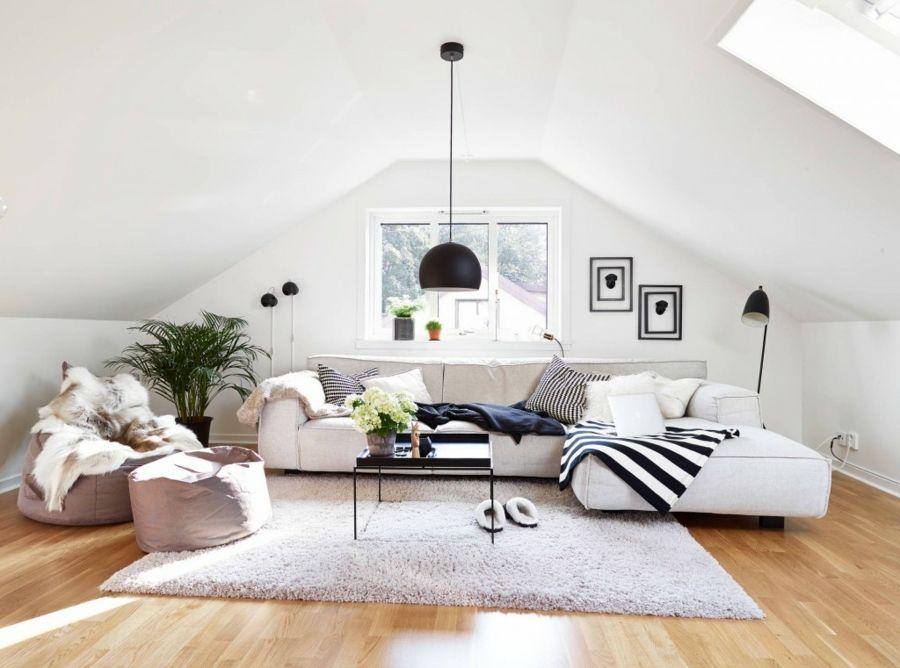 Wohnzimmer Dachraum skandinavisch Stil Ecksofa Hängeleuchte