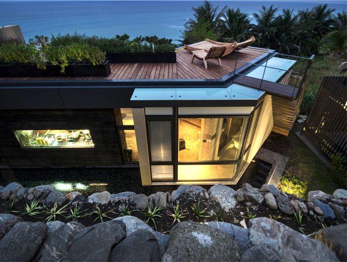 Designhaus Wohnidee Natur Stein Holz Pazifik Garten Dachterrasse romantisch