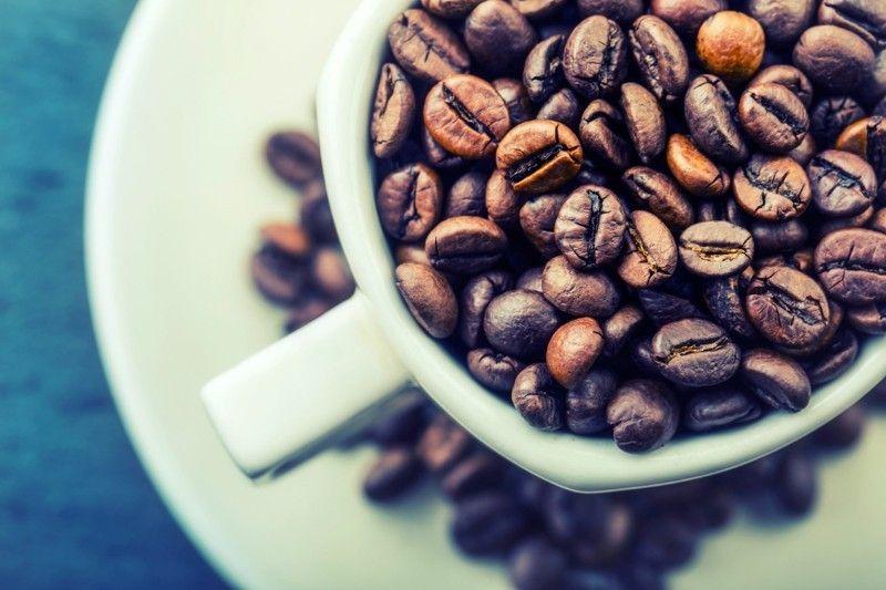 Kaffeebohnen weißer Tasse Gesunde Ernährung