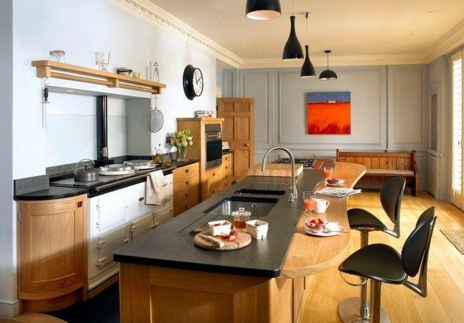 trendige Küche im Landhausstil schwarze Küchenplatte