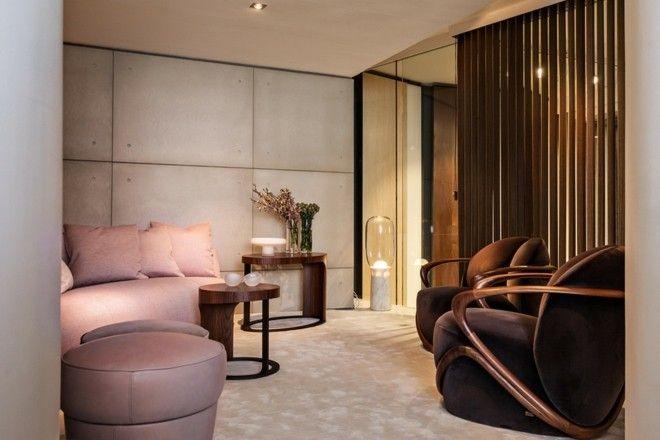 beistelltisch-rosa-sofa-leder-hocker-teppichboden-wohnzimmer-einrichten