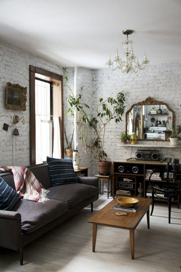 wohnzimmer-im-boho-stil-couch-schwarze-mobel